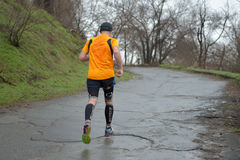 Athlete is taking part in duathlon competition Stock Photo
