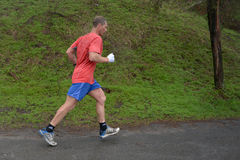 Athlete is taking part in duathlon competition Stock Image
