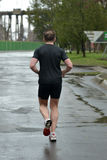 Athlete is taking part in duathlon competition Stock Photography