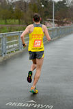 Athlete is taking part in duathlon competition Royalty Free Stock Images