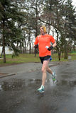Athlete is taking part in duathlon competition Stock Photos
