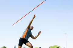 Athlete throwing a javelin. In the stadium royalty free stock photos