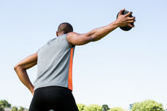 Athlete about to throw a discus. Rear view of athlete about to throw a discus in stadium Royalty Free Stock Photos