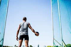 Athlete about to throw a discus royalty free stock image