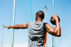 Athlete about to throw a discus Stock Photo
