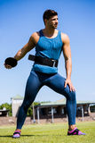 Athlete about to throw a discus. In stadium Stock Photo