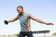 Athlete about to throw a discus. In stadium Royalty Free Stock Images