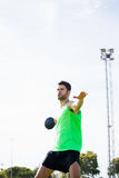 Athlete about to throw a discus. In stadium Stock Image