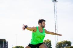 Athlete about to throw a discus. In stadium Stock Photos