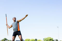 Athlete about to throw a javelin. Close-up of athlete about to throw a javelin in the stadium Royalty Free Stock Image