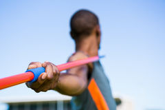 Athlete about to throw a javelin. Close-up of athlete about to throw a javelin in the stadium royalty free stock photo