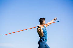 Athlete about to throw a javelin. Determined athlete about to throw a javelin in the stadium stock photos