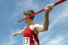 Athlete About To Throw Javelin. Male athlete about to throw javelin against the sky Stock Photos