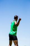 Athlete about to throw a javelin. Rear view of athlete about to throw a javelin in the stadium Royalty Free Stock Images