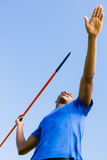 Athlete about to throw a javelin. In the stadium stock photography