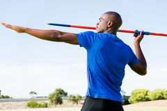 Athlete about to throw a javelin. In the stadium royalty free stock images
