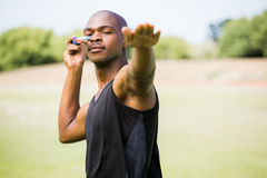 Athlete about to throw a javelin. In the stadium royalty free stock photography