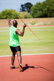 Athlete about to throw a javelin. In the stadium stock image
