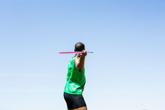 Athlete about to throw a javelin. In the stadium Royalty Free Stock Image
