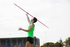 Athlete about to throw a javelin. In stadium Royalty Free Stock Images