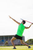 Athlete about to throw a javelin. In stadium Royalty Free Stock Photos