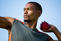 Athlete about to throw shot put ball. Close-up of determined athlete about to throw shot put ball stock photography