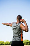 Athlete about to throw shot put ball. Rear view of athlete about to throw shot put ball in stadium royalty free stock photo