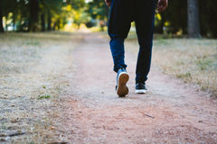 Athlete took a break after fast cardio running and just walking stock images
