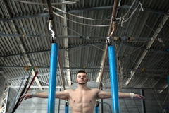 Athlete topless preparing to give gymnastic Royalty Free Stock Images