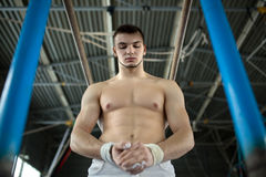 Athlete topless preparing to give gymnastic Stock Photo