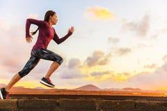 Athlete trail running woman runner training cardio. Athlete trail running silhouette of a woman runner at sunset sunrise. Cardio fitness training of marathon stock images
