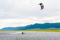 Athlete train by kitesurfing. On the lake Royalty Free Stock Photos