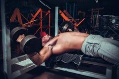 Athlete training with dumbbells Stock Photos