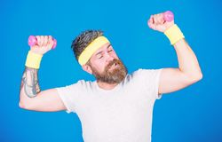 Athlete training with tiny dumbbell. Motivated athlete guy. Sportsman training with dumbbells blue background. Improve. Your muscles. Man bearded athlete stock photos