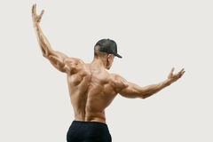 Athlete turning back and rise both hands Royalty Free Stock Photos