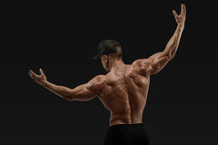 Athlete turning back and rise both hands Royalty Free Stock Photography