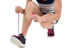 Athlete tying her shoe lace Royalty Free Stock Photo