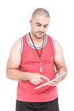 Athlete using digital tablet Royalty Free Stock Images