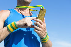 Athlete Using Gold Medal Mobile Phone Stock Photography