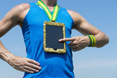 Athlete Using Gold Medal Tablet Computer Stock Photo