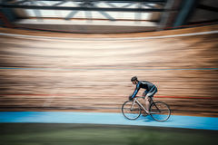 Athlete at velodrome. Athlete with a bicycle at velodrome Stock Image