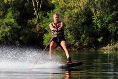 Athlete on the wakeboard Royalty Free Stock Photography