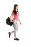 Athlete walking and carrying a sports bag Royalty Free Stock Photography