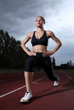 Athlete warm up stretch on athletics running track Royalty Free Stock Photos
