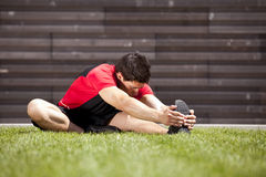 Athlete warming and stretching Royalty Free Stock Photo
