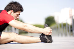 Athlete warming and stretching Stock Photos