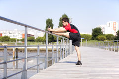 Athlete warming and stretching Royalty Free Stock Photography
