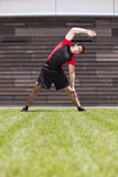 Athlete warming and stretching Stock Images
