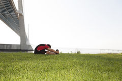 Athlete warming and stretching Royalty Free Stock Image