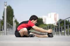 Athlete warming and stretching Stock Photography